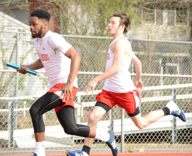 Khalik Harmon of Williamsport takes the baton from Austin Murray in the 1,600 relay Thursday at Montoursville.