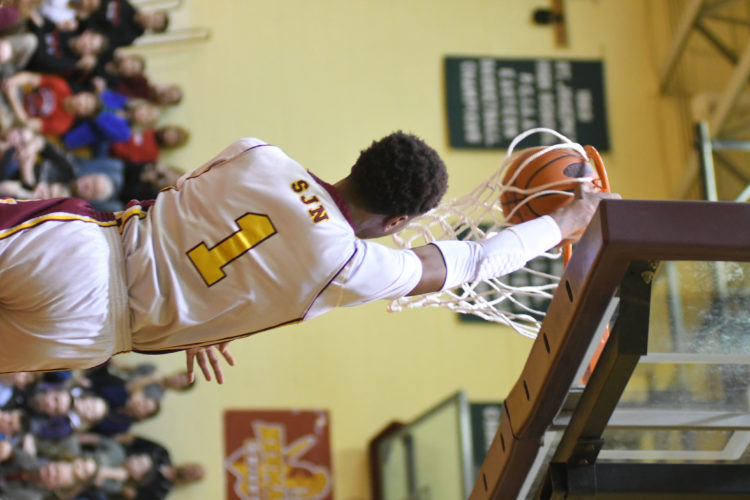St.JohnNeumann senior KevinAnderson dunks during a game against NorthPenn-Liberty in the District 4 Class A playoffs this year. Anderson was named the Class A Player of the Year. (MARK NANCE/Sun-Gazette)