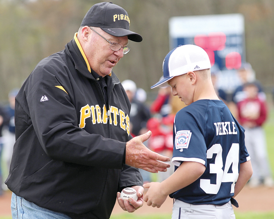 Former MLB player Ed Ott shakes the hand of Elijah Weikle of the Muncy Bank & Trust Little League team after Ott threw out the first pitch at Lighted Field during Little League Opening Day at Kiess Park in Muncy Twp. April 22, 2017. Muncy Little League, which was founded in 1947, has 17 teams in the league. DAVE KENNEDY/Sun-Gazette Correspondent