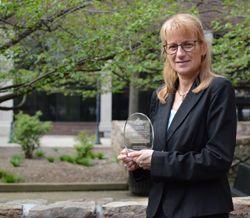 Lycoming County Assistant District Attorney Melissa Kalaus holds the award she received for being named one of The Animal Legal Defense Fund's Top Ten Animal Defenders, specifically for her work to save a puppy named Luke from a potentially abusive home.