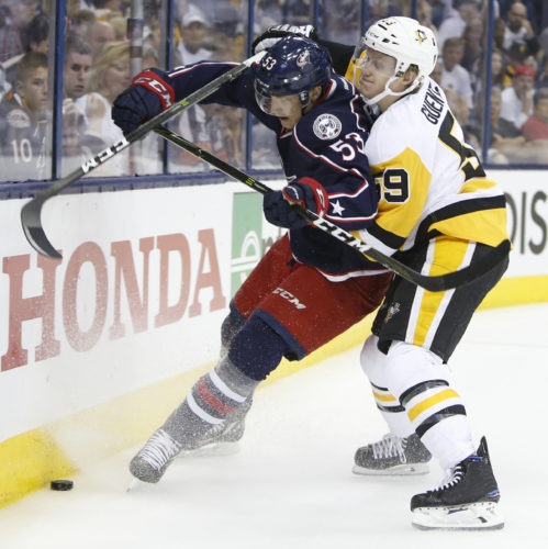 The Pittsburgh Penguins' Jake Guentzel, right, checks the Columbus Blue Jackets' Gabriel Carlsson during Game 3 on Sunday. (AP)