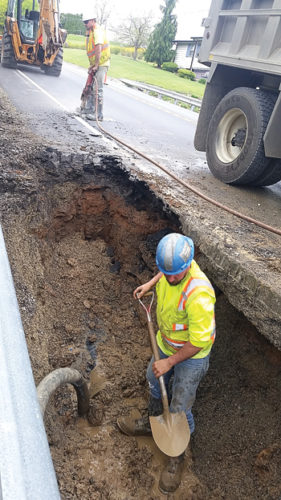 PHILIP A. HOLMES/Sun-Gazette Williamsport Municipal Water Authority employees spent several hours Tuesday repairing a water main break on Four Mile Drive, just west of Warrensville Road. The break, which occurred about 11 a.m., involved the same 12-inch main that ruptured on July 25, 2015, and occurred less than 12 feet from the earlier incident. Numerous homes were without water as crews worked into the night. Among the properties affected were the Valley View Nursing Center and Elmcroft Senior Living, both of which put contingency plans in place so their residents would have water.