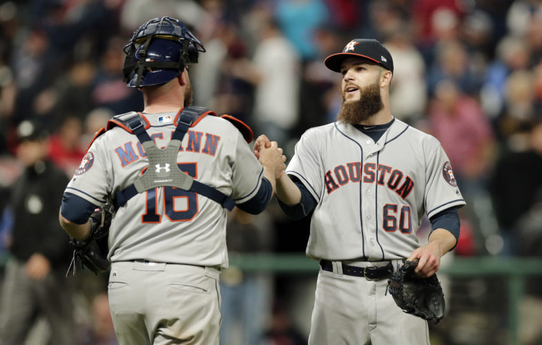 Houston Astros starting pitcher Dallas Keuchel (60) is congratulated by catcher Brian McCann (16) after the Astros defeated the Cleveland Indians, 4-2, on Tuesday in Cleveland. (AP)