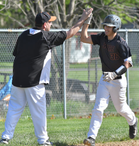 Jersey Shore's Bradon DePasqua  is congratulated by his third base coach Mike English after hitting a three-run home run in the first inning at Jersey Shore on Wednesday against Central Mountain. (MARK NANCE/Sun-Gazette)