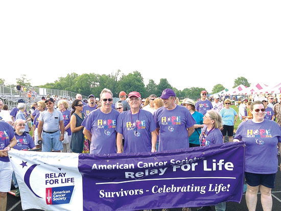 PHOTO PROVIDED Al Henry, center, is shown in 2015 at the RFL of Lewisburg during the survivor and caregiver lap, the year he served as honorary chairperson. Michael Wright, to Henry's right, served as honorary chairperson for the event in 2010.