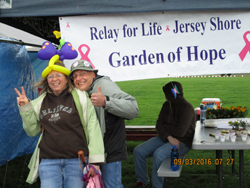 PHOTO PROVIDED Julia and Jeff Welshans, members of Survivors and Caregivers Relay For Life team, pose for a photo by their tent site at a previous Relay For Life of Jersey Shore event.