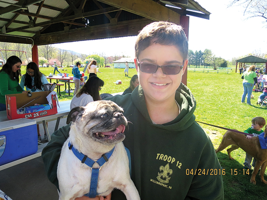 PHOTO PROVIDED Gabriel Carson, 14, and his puppy, Cooper, are shown at last year's Bark For Life event.
