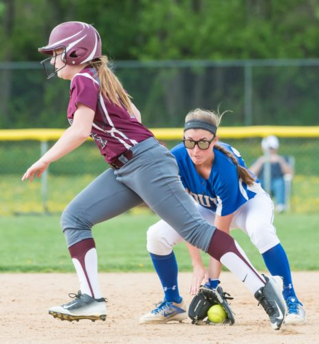 NICK FIORINI/For The Sun-Gazette Paige Lentz of South Williamsport fields a grounder as Loyalsock's Sam Stopper advances Thursday at South Williamsport.