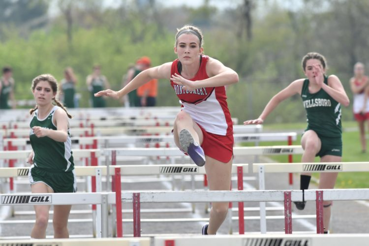 MARK NANCE/Sun-Gazette Montgomery's Katie Forrestal clears a hurdle near the end as she holds the lead in the 100 hurdles Thursday vs. Wellsboro.