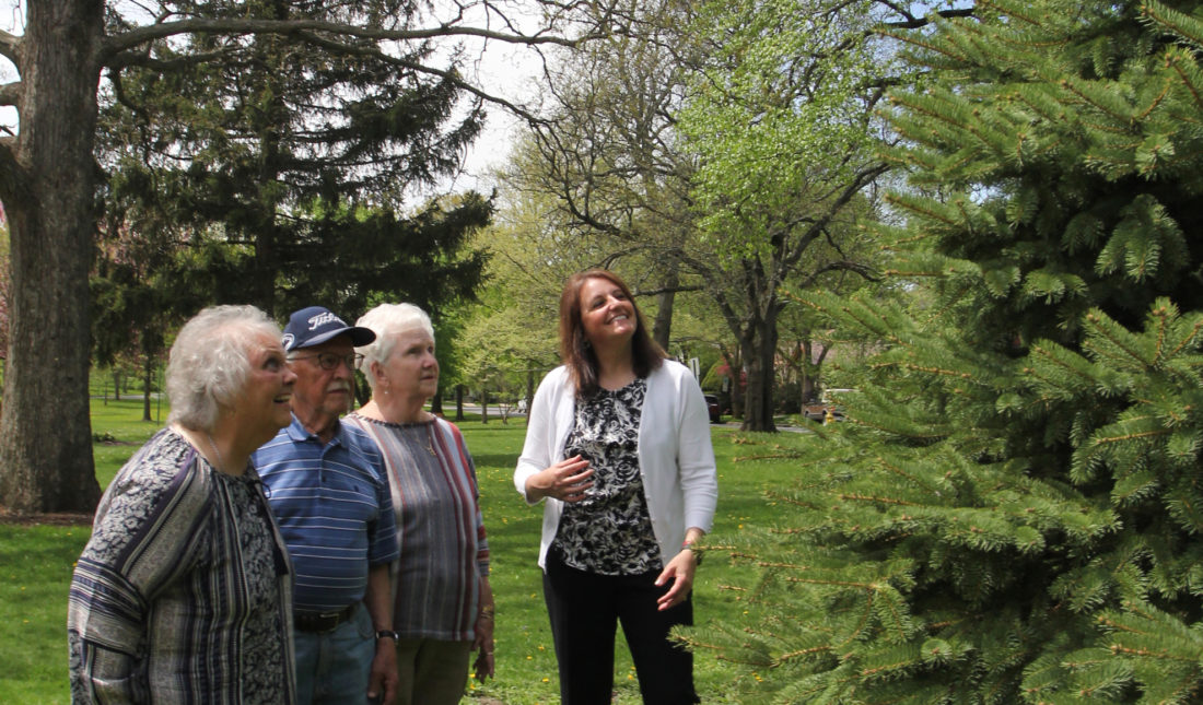 KAREN VIBERT-KENNEDY/Sun-Gazette Paternostro family members look at the Blue Spruce tree in remembrance of Thomas A. Paternostro during the Arbor Day 2017 program hosted by the City of Williamsport, the Brandon Park Commission and the Shade Tree Commission at Brandon Park on Friday afternoon.  Family members are from left to right; Marty, Thomas' wife;  Joe and Jean Paternostro, Thomas' brother and sister-in-law; and Krista Bower, Thomas' daughter.