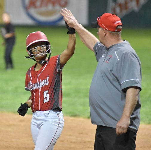 MARK NANCE/Sun-Gazette Brittany Thompson high-fives her coach after a single Friday at Elm Park.