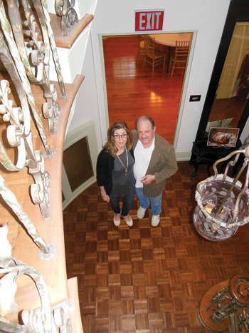 MIKEREUTHER/Sun-Gazette Charlie and Carmen Bush pose inside Bush House, which following extensive renovations is available for banquets, weddings and other events. The venue also sports an Italian marble fireplace, conference room, banquet rooms and tea house.