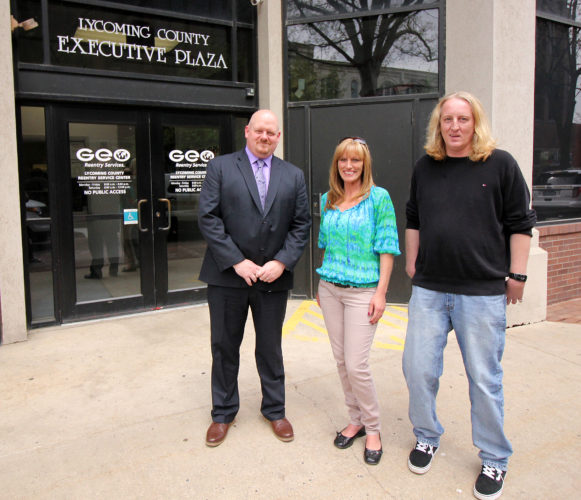 ANNE REINER/Sun-Gazette  Michael Boughton, left, program manager for GEO Reentry Services, Mary Ambrose, center, and Ron Michaels, right, stand outside the Lycoming County Reentry Services Center on Pine Street.