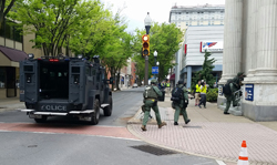 PHILIP A. HOLMES/Sun-Gazette Members of the Montour-Columbia County Special Response Team storm the Williamsport/Lycoming Chamber of Commerce building at West Fourth and Pine streets during Sunday's mock terrorist attack.