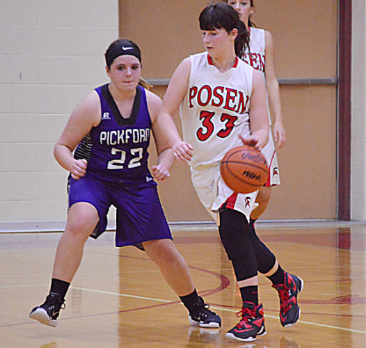 News Photo by Jonny Zawacki Posen's Brooke Ciarkowski (33) attempts to dribble around Pickford defender Tori Thurmes (22) during the third quarter of a girls basketball game at Posen High School on Tuesday.