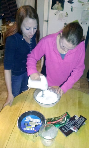 Courtesy Photo Alpena resident Jeanette Swoffer, left, supervises her niece Micaela Chrivia in making a holiday chocolate cream pie. Swoffer said she makes as many as 25 for family and friends during the holidays.