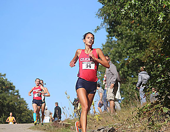 Courtesy Photo Elaine LaBarge runs downhill during a cross country meet. LaBarge was a standout at Alpena High School and eventually went on to run for and lead Cleary University to its first ever national championship.