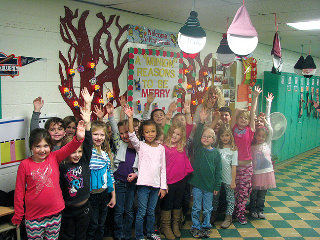 News Photo by Tyler Winowiecki First -graders from Polly Hunter's first grade class indicate who is excited for the Christmas season.