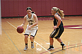 News Photo by Jonny Zawacki Alpena's Alexis Smith attempts to dribble the ball past Lakers defender Clara Loukus during the second quarter of women's basketball game on Saturday at Park Arena.