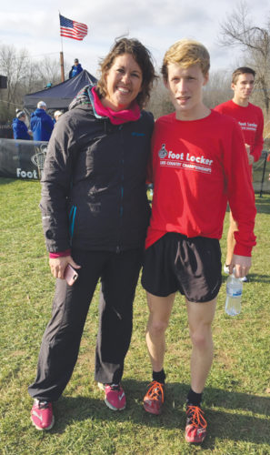 Courtesy Photo Alpena High senior Mitchell Day, pictured here with Alpena cross country coach Joy Bullis, will run on Saturday in the Foot Locker National Championships in San Diego. Day, who is headed to Wake Forest to run collegiately, will try to end his high school career as an All-American by finishing in the top 15 out of 40 runners.