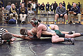Courtesy Photo Alpena's Emery Zarins pins Gaylord's Cade Foster during a wrestling match on Wednesday at St. Ignace High School.
