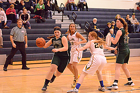 News Photo by Jonny Zawacki Alpena's Dakota Prevo (44) dribbles past Alcona defenders Kendra LaFave (12) and Madison Lane (20) on her way to scoring on a layup during the third quarter of a girls basketball game on Wednesday at Alcona High School.