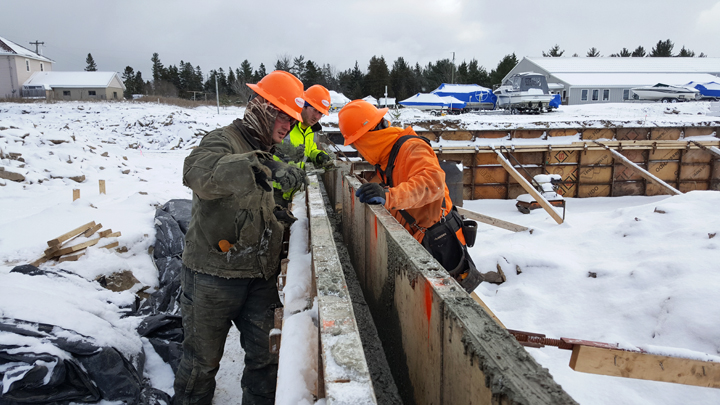 News Photo by Jason Ogden Left to right, Michael Munro, Ryan MacKinnon and Steve Kinsel of Oak City Contracting work on cement work at the site of the new Thunder Bay Transportation Authority building Friday.