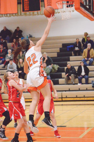 News Photo by James Andersen Rogers City's Taylor Fleming (22) soars in for a layup during the first half of a girls basketball game on Friday at Rogers City High School. Fleming scored 16 points and the Hurons defeated Posen for the first time since 2010.