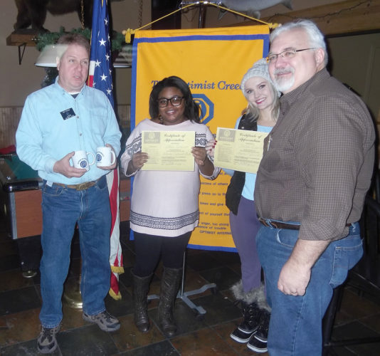 HB4116 Courtesy Photo Optimist members Bud Pfeifer, left, and Pastor Rich George, right, thank Star Connor, left center, and Teresa Lipowski, right center, for presenting to the Optimist Club.