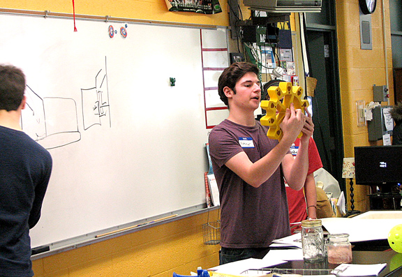 News Photo by Tyler Winowiecki Conner McDonald explains his team's concept to the rest of the robotics students during Sunday's brainstorming session. McDonald and the other students worked with area engineers to brainstorm ideas for the upcoming FIRST Robotics Competition.