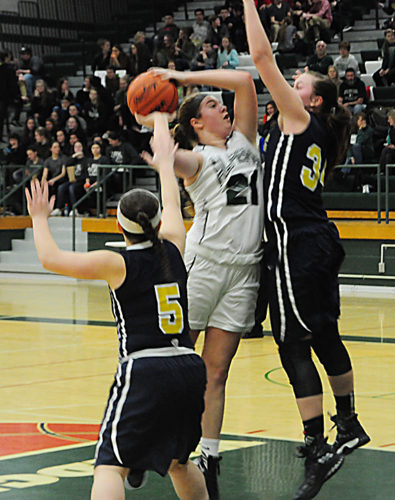 News Photo by Jonny Zawacki Alpena's Shelby Seaver (21) takes a shot while being defended by Viking defenders Kylie Christensen (34) and Morgann Kanouse (5) during a Big North Conference girls basketball game on Friday at Alpena High School.