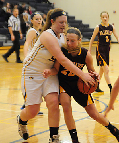 News Photo by Jonny Zawacki Alcona's Brittany Decker (50) prevents Fairview's Jenna DeJarlais (22) from getting into the paint during the third quarter of a girls basketball game on Monday at Alcona High School.
