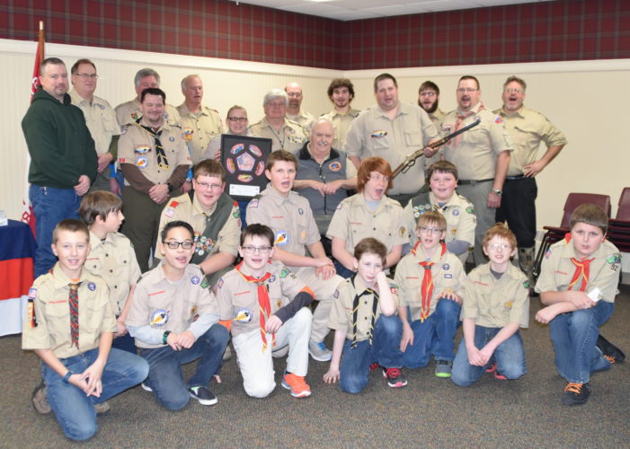 Courtesy Photo Longtime Scoutmaster Dennis Johnson is surrounded by other leaders and Scouts during a recent Court of Honor at which he received recognition.