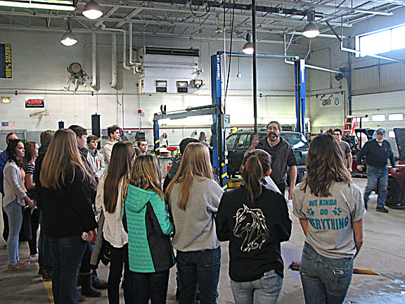 News Photo by Tyler Winowiecki  Automotive technology teacher Mark Hay explains to eighth grade students the different classes available through the auto shop. Students can opt to take just a basic maintenance class or work toward their motor vehicle mechanic certification through the classes offered at Alpena High School.