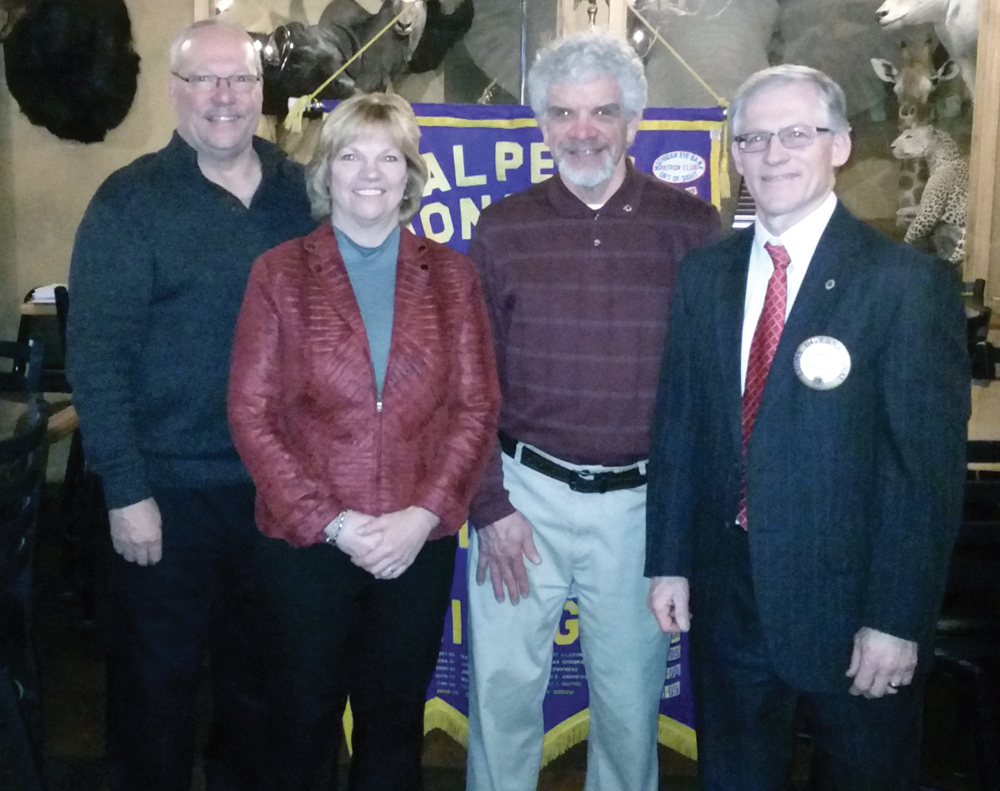 Courtesy Photo Joe Garant, second from right, was inducted recently into the Alpena Lions Club. Past District Gov. Dave Zeller, left, conducted the ceremony. Second from left, President Paulette Roznowski welcomed Garant into the club, and Bernie Lamp III served as his sponsor.