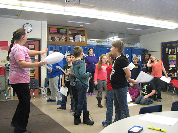 News Photo by Tyler Winowiecki Karen Kron-Dickson, left, instructs third grade students from Amber Loney's class Wednesday morning. Kron-Dickson along with Molly Zaleski from 4th Wall Theatre are visiting Besser Elementary for the week to practice for the student's performance on Friday.