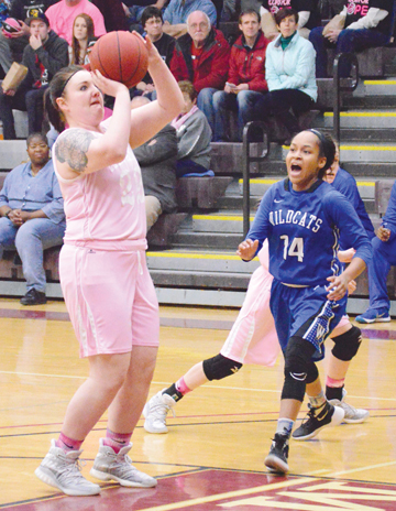News Photo by James Andersen Alpena's Anne Archambeau, left, shoots during the first half of a women's basketball game on Saturday at Park Arena. Defending her on the play is Wayne's Jelani Shinn.