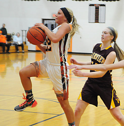 News Photo by Jonny Zawacki Hillman senior Vanessa Schook (12) races past Fairview defender Andrea Ford and scores on a layup during the third quarter of a girls basketball game on Monday at Hillman High School.
