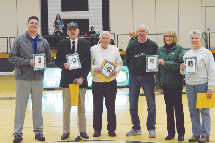 News Photo by James Andersen Alpena High School honored its five newest inductees into the Athletic Wall of Fame last Friday during halftime of Alpena's boys basketball game with Traverse City West. Pictured from left to right are: Troy Reeder, Terry Thomas, Tom Lavoie, Leaird and Judy Cameron (representing Kim Cameron) and Vicki Herman (representing Anna Herman).