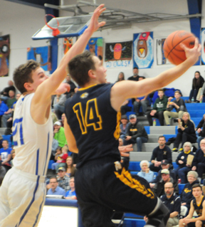 News Photo by Jonny Zawacki Alcona's Jordan Steiner (14) goes up for layup while being defended by Oscoda's Grant Huebel (21) during the fourth quarter of a boys district semifinal basketball game on Wednesday at Oscoda High School.