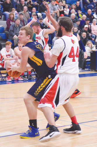 News Photo by James Andersen Alcona's Luke Loyer, left, drives to the basket while being defended by Whittemore's Shawn Edmonds.