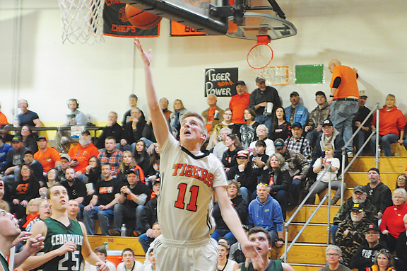 News Photo by Jonny Zawacki  Hillman's Andrew Funk (11) scores on a layup during the third quarter of a boys Class D regional semifinal game on Monday at La Salle High School in St. Ignace.