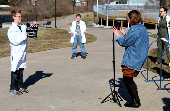 """News Photos by Jordan Spence Avery Damp, 11, calls """"Action"""" while AmeriCorp volunteer Olivia Rose films a PSA video at the Great Lakes Maritime Heritage Center Tuesday. The Ella White fifth-grader was there with his class as STEM initiative field trip."""