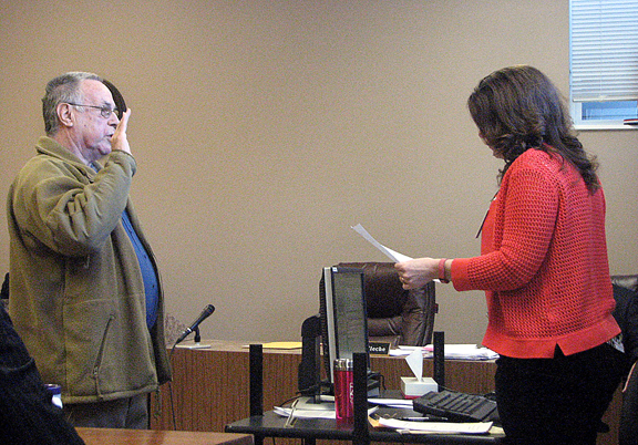 News Photo by Tyler Winowiecki Dave Wagner takes the oath of office after being voted onto the Montmorency County Board of Commissioners. Wagner will assume the role of District Four commissioner after former Chairman Gene Thornton resigned earlier this month.