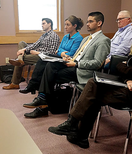 News Photo by Jordan Spence  Representatives from 911 equipment companies at a special Presque Isle County Board of Commissioners meeting Thursday.