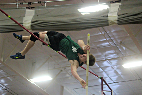 Courtesy Photo Alec LeTourneau pole vaults up and over a bar during an indoor meet while competing for The Woods Track and Field Club earlier this season.