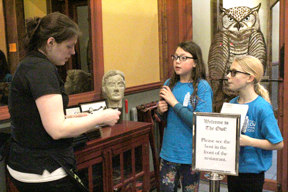 News Photo by Jordan Spence Plastics FLOAT (For the Love of Alpena Today) members Sydney Silver, 11, and Sylvie Luther, 10, talk with OWL server Dana Bailey about Zero Waste Week Thursday. The students went around asking restaurants to give customers straws only if requested.