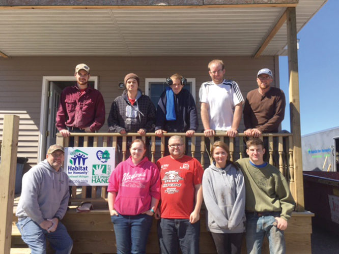 Courtesy Photo Shown above are those who helped Habitat for Humanity Northeast Michigan on a recent Saturday Service Day at a Habitat construction site on Long Lake Avenue