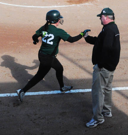 News Photo by Jonny Zawacki Alpena's Lizzy Heath (22) is congratulated by coach Paul Marwede after hitting a home run during the third inning in game one of a softball doublheader on Thursday at Alpena High School.