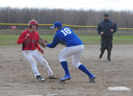 News Photo by Jonny Zawacki Oscoda third baseman Travis Lamrock (18) tags out Posen baserunner Jared Sharpe (1) as he attempts to steal third during the first game of a baseball doubleheader on Monday in Posen.